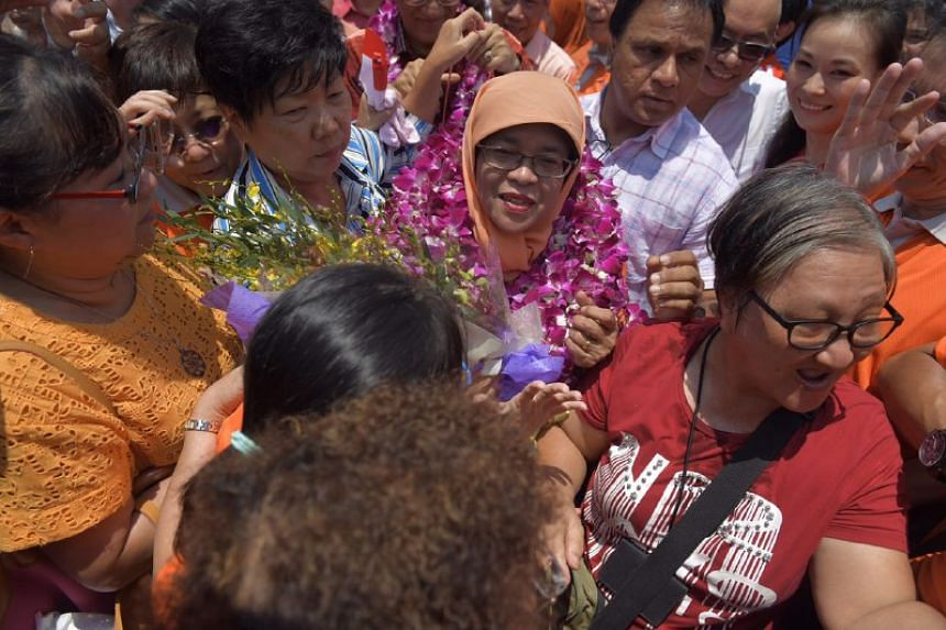 Madam Halimah Yacob being congratulated by supporters after her acceptance speech on Sept 13, 2017.