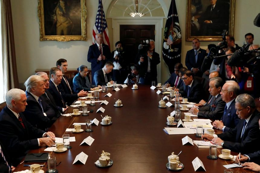 Mr Trump and Mr Najib meeting in the Cabinet Room of the White House.