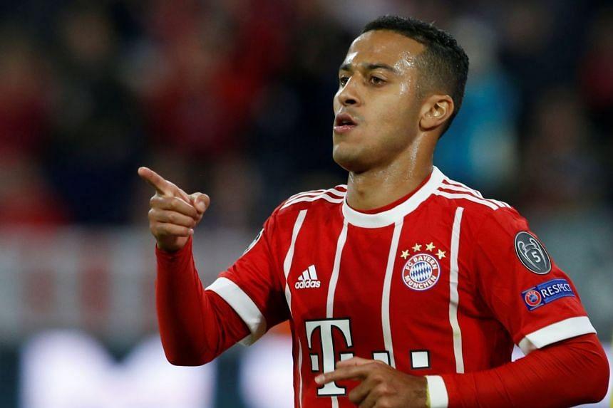 Bayern Munich's Thiago Alcantara celebrates scoring their second goal.