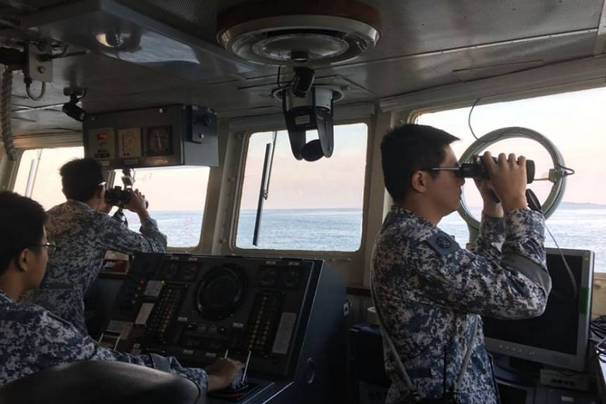 Crew on board the RSS Fearless surveying the horizon to locate the missing crew from JBB DE RONG 19.