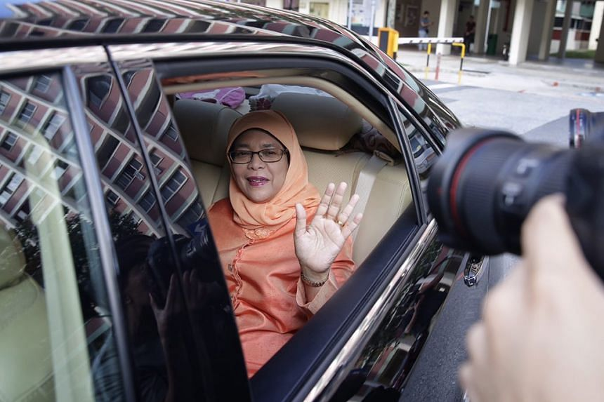 Madam Halimah Yacob waving from her car as she leaves her Yishun flat for NTUC Centre on Sept 13, 2017.