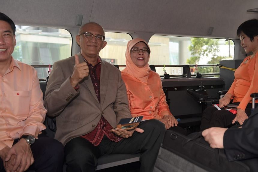 Madam Halimah Yacob and her husband Mohamed Abdullah Alhabshee in a van headed for the nomination centre on Sept 13, 2017.