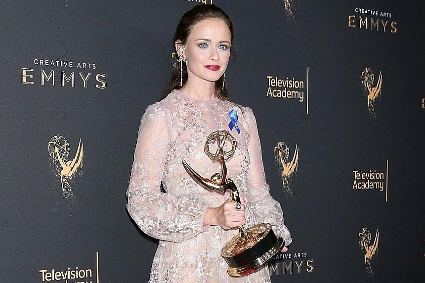 Alexis Bledel with her Drama Guest Actress trophy at The Creative Arts Emmy Awards.