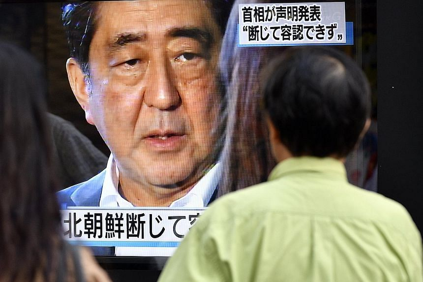 A news broadcast of Mr Shinzo Abe speaking on Sept 3 after North Korea's nuclear test. The Japanese leader has been in the media spotlight as tension rises over the North's missile and nuclear tests.