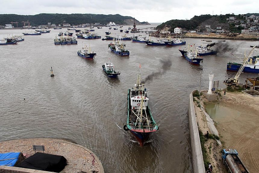 Fishing vessels along the Zhejiang coastline seeking shelter yesterday at waterways with stronger resistance against the wind as Typhoon Talim is expected to hit the area this week.