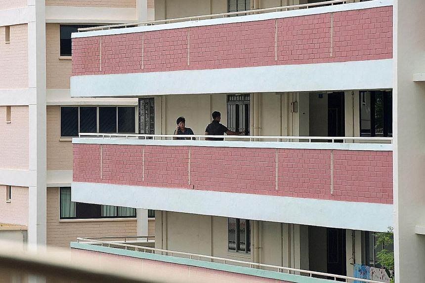 Security officers outside Madam Halimah Yacob's home in Yishun yesterday. The 12-storey HDB block built in 1987 has been home to Madam Halimah and her family for more than two decades, and she has lived there throughout her 16-year political career.