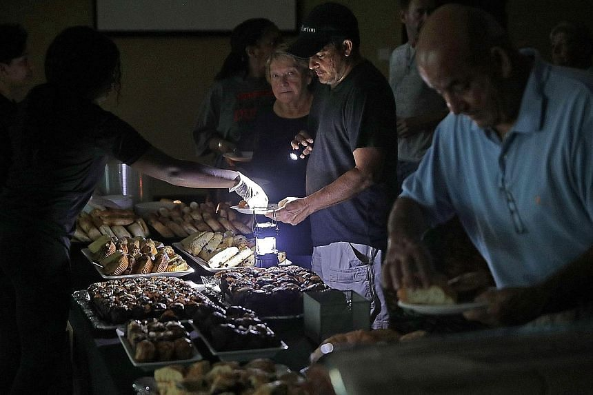 Hotel guests being served breakfast by lamplight as the power remained off at the Marriott. The aftermath of Hurricane Irma as seen from the air over the Florida Keys. Officials warned that it would take a long time to repair the damage wrought by hi