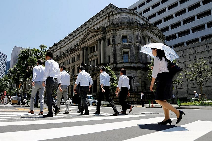 The Bank of Japan building in Tokyo. With the BOJ committed to holding down the benchmark bond yield at around zero per cent, Japanese banks are following the nation's largest insurance firms in considering more alternative assets as choices narrow.