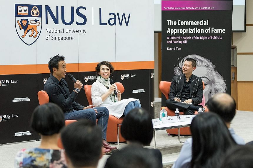 Television host Allan Wu (left) and singer-actress Kit Chan at the launch of The Commercial Appropriation Of Fame by Associate Professor David Tan (right).