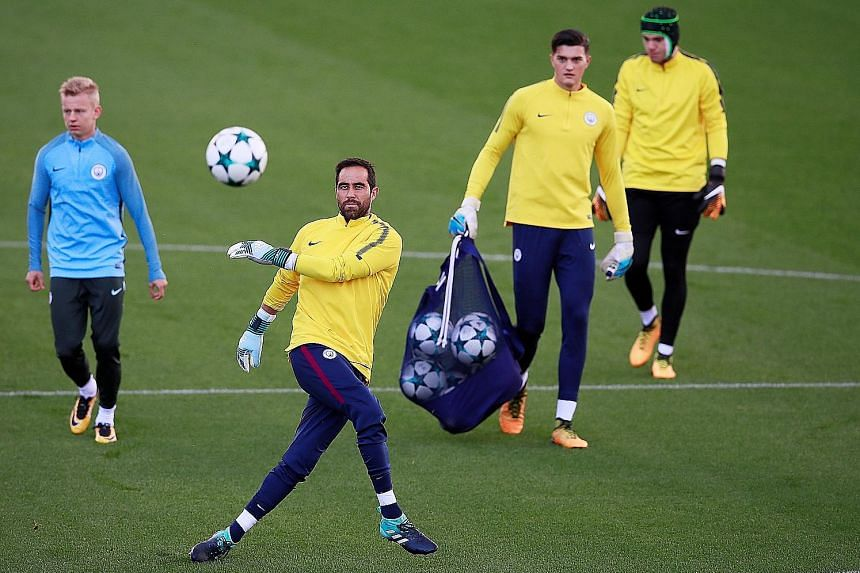 Manchester City goalkeeper Claudio Bravo practising his kicking in training. He will stand in for Ederson in their Champions League group tie at Feyenoord today, should the Brazilian custodian not recover in time after being kicked in the face by Liv