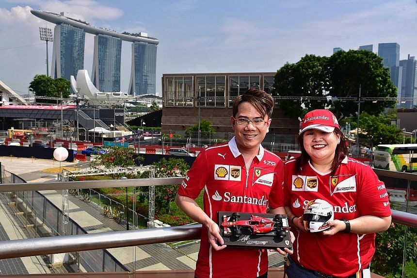 Bank analyst Ang Chi Song, 33, and nurse Daphne Soh, 29, have never missed a race at the Marina Bay Street Circuit and are now part of an F1 fan group whose members stay in touch on WhatsApp.