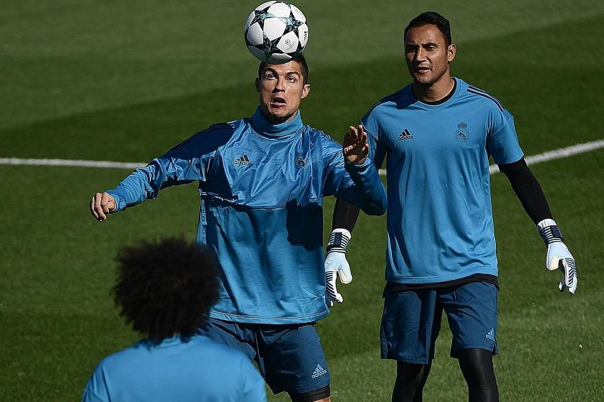 Real Madrid forward Cristiano Ronaldo and his team-mates training ahead of today's clash against APOEL. His return will be a boon with striker Karim Benzema injured.