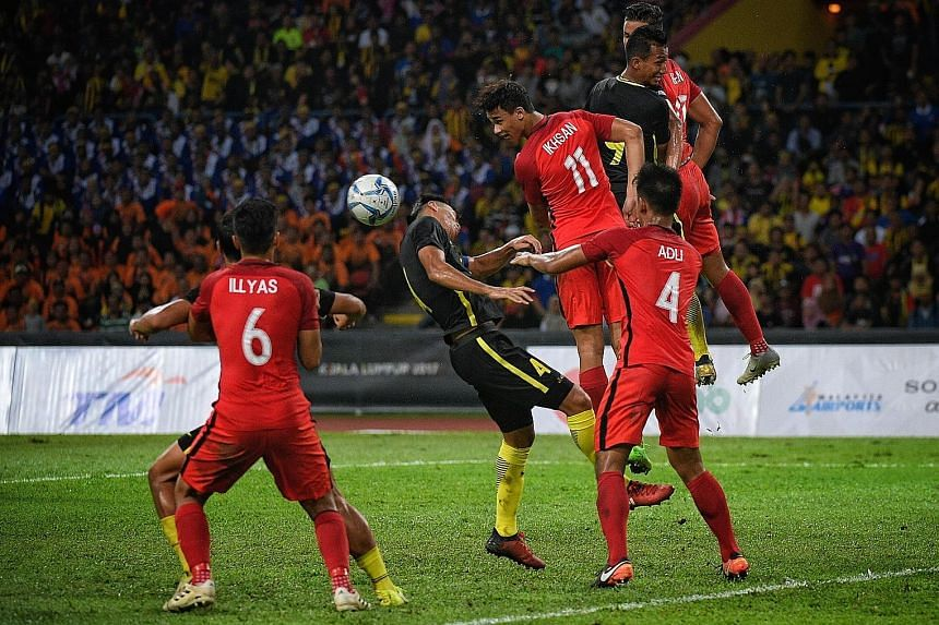 Ikhsan Fandi heading during Singapore's 2-1 defeat by Malaysia at the SEA Games in Kuala Lumpur last month. The Young Lions were eliminated at the group stage.
