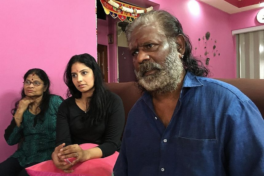 Mr S. Jaganathan with his wife and daughter. The veteran Hindu fire-walker is seeking costs for present and future medical expenses, loss of future earnings and compensation for pain, among other things.