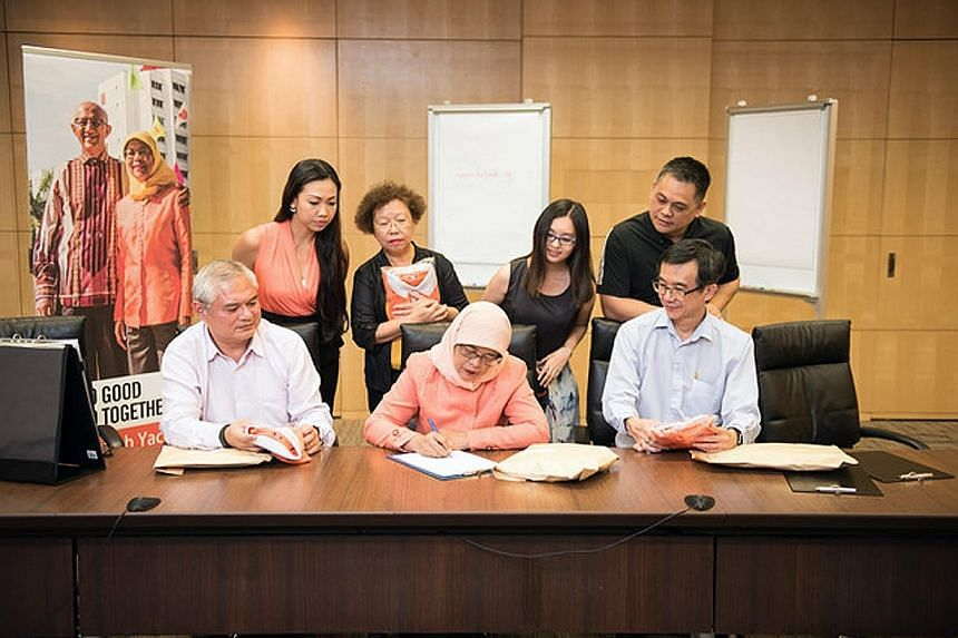 Madam Halimah, who will be declared president-elect today, will address supporters gathered at the People's Association Headquarters. Madam Halimah Yacob, surrounded by key members of her team, writing a letter to thank Singaporeans for their show of