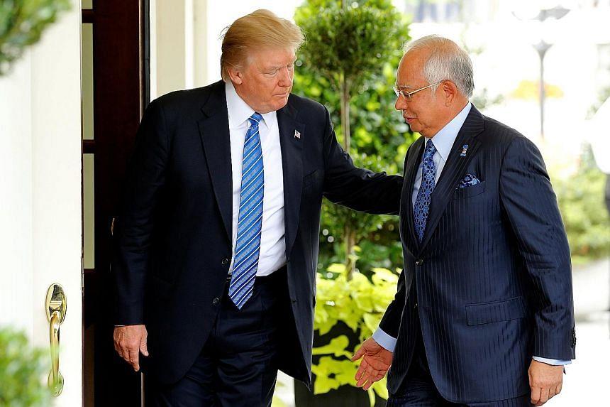 US President Donald Trump welcoming Malaysian Prime Minister Najib Razak to the White House in Washington yesterday.