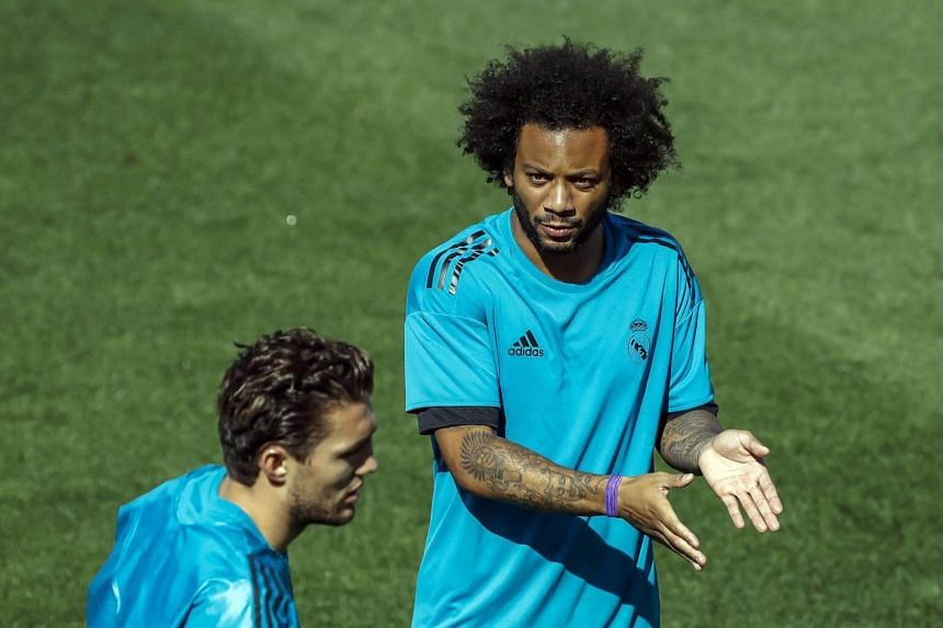 Real Madrid's Marcelo (right) and Mateo Kovacic react during a training session of the team at the Valdebebas sports facilities in Madrid, Spain on Sept 12, 2017.