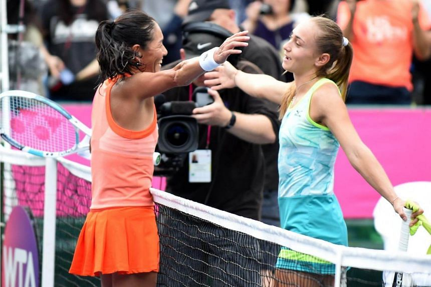Japan's Kimiko Date (left) tries to hug Aleksandra Krunic of Serbia after their first round match of the Japan Women's Open tennis tournament in Tokyo on Sept 12, 2017.