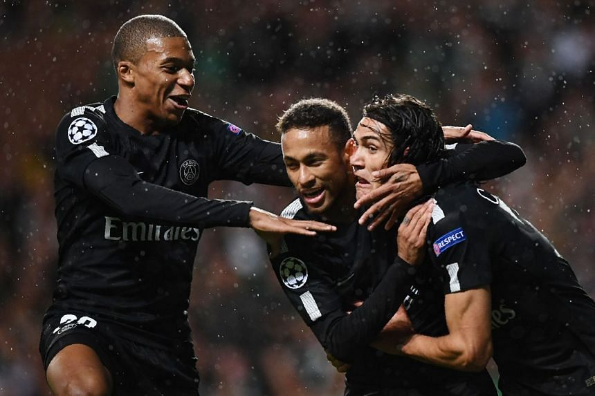 Neymar (centre) celebrates with PSG's Kylian Mbappe (left) and Edinson Cavani after scoring the opening goal.