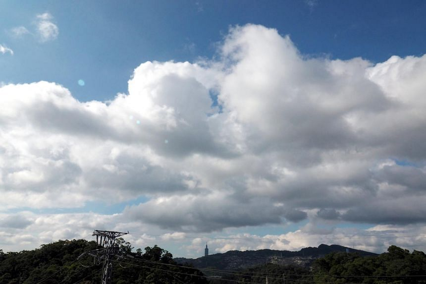 Clouds cover the sky in Taipei, Taiwan, on Sept 12, 2017. According to the Central Weather Bureau, Talim is expected to skirt Taiwan's northern tip late on Sept 13 early on Sept 14, before turning northeast and charging towards Japan.