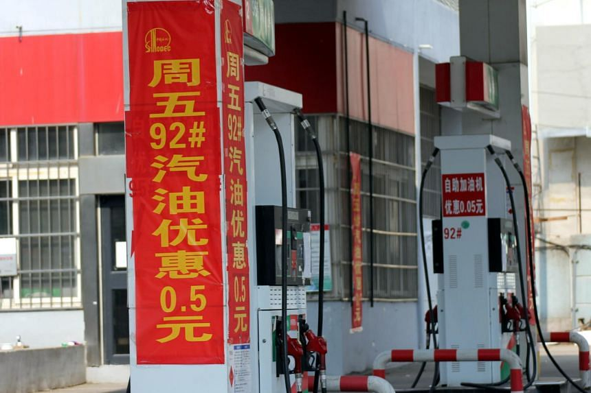 Banners showing discounts of gasoline prices at a Sinopec gas station in Qingdao, Shandong, China on March 27, 2017.