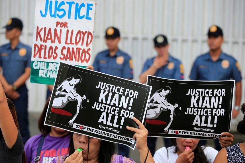 Protesters hold placards seeking justice for 17-year-old high school student Kian delos Santos, who was killed in a recent police raid in an escalation of President Rodrigo Duterte's war on drugs, during a protest in front of the Philippine National