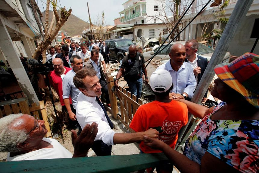 France's President Emmanuel Macron greets residents during his visit to the French Caribbean island of St. Martin, on Sept 12, 2017.