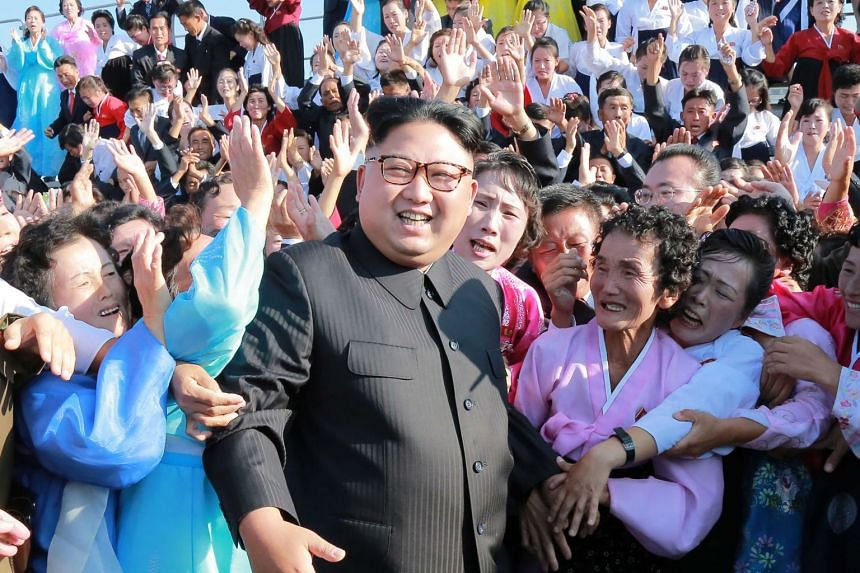 A picture released on Sept 12, 2017, shows North Korean leader Kim Jong-Un (centre) attending a photo session with teachers in Pyongyang.