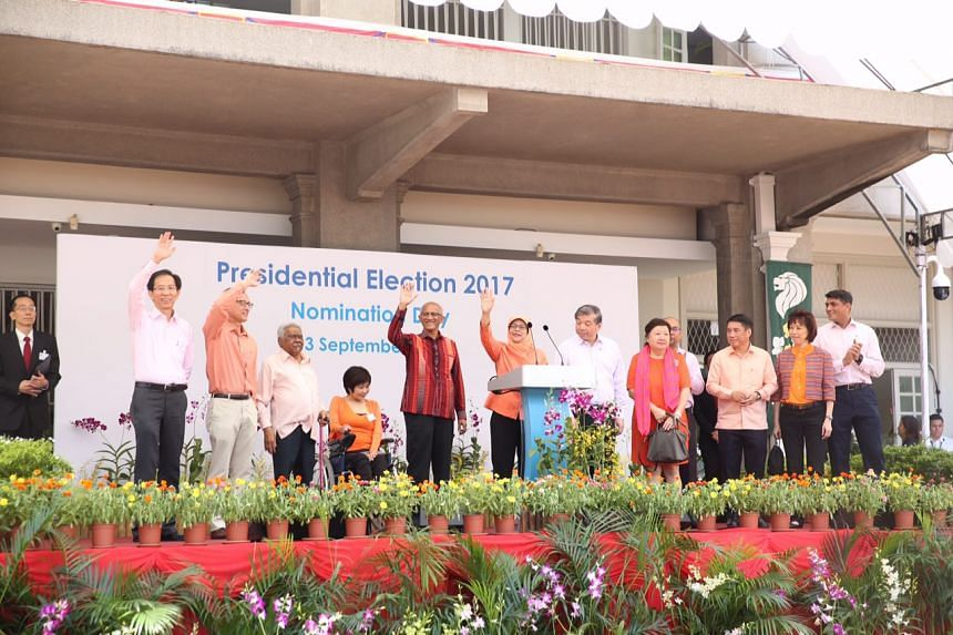 Singapore's president-elect Madam Halimah Yacob waving to supporters after her speech at the People's Association HQ.