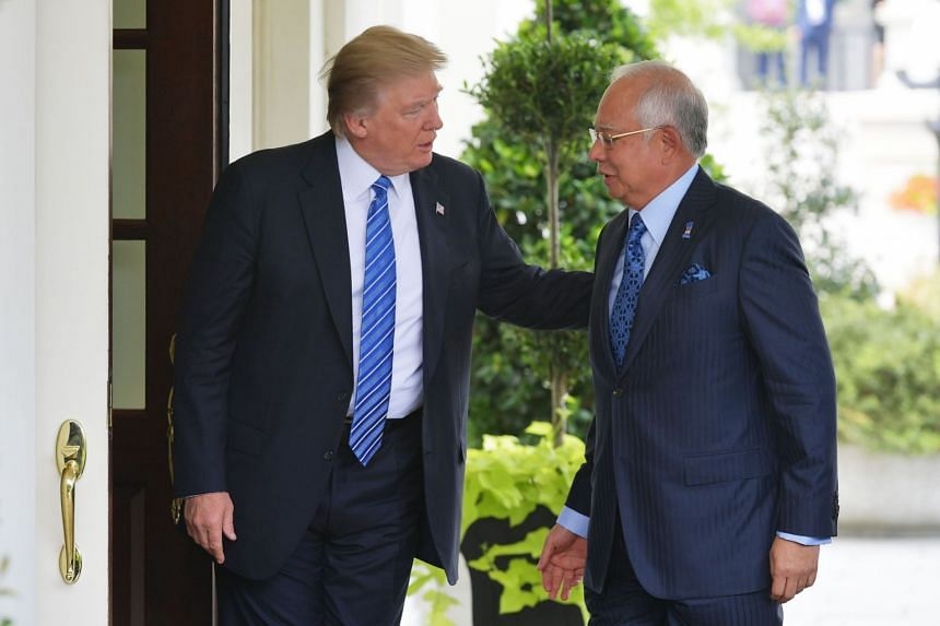 Donald Trump greets Najib Razak outside of the West Wing of the White House.