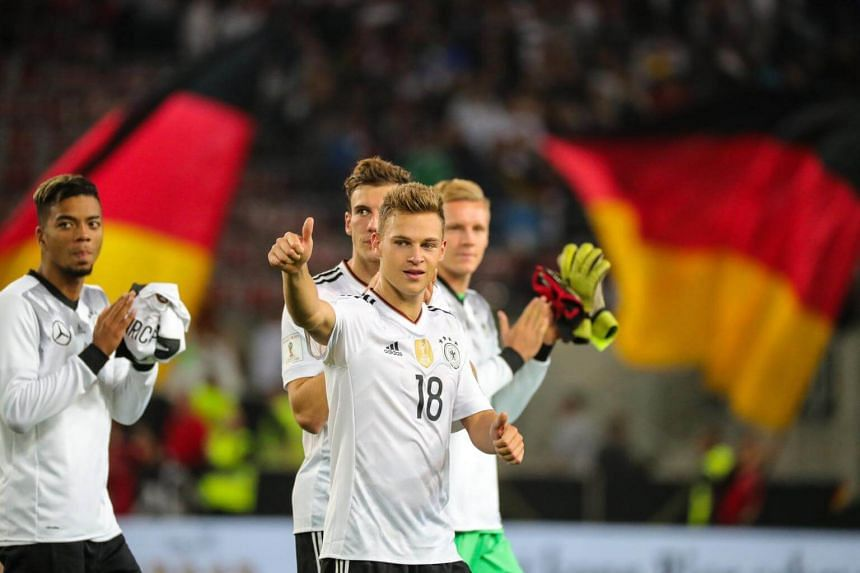 Germany's Joshua Kimmich and his teammates acknowledging their fans after their match against Norway in Stuttgart on Sept 4, 2017.