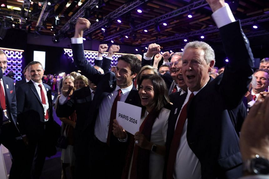 Paris delegates react to the decision at the 131st IOC session in Lima, Peru, Sept 13, 2017.