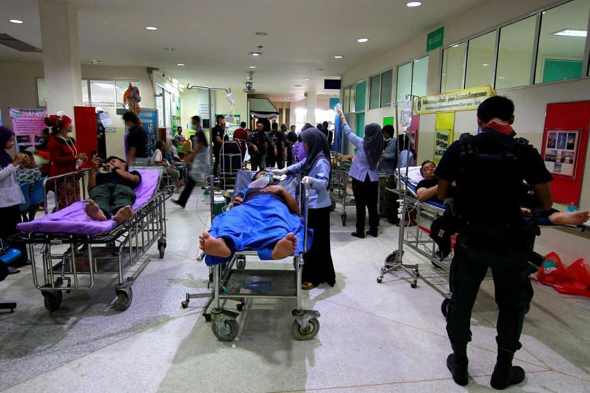 Military personnel are seen in a hospital after a roadside bomb blast in the southern Malay Muslim province of Yala, Thailand, on Sept 14, 2017.