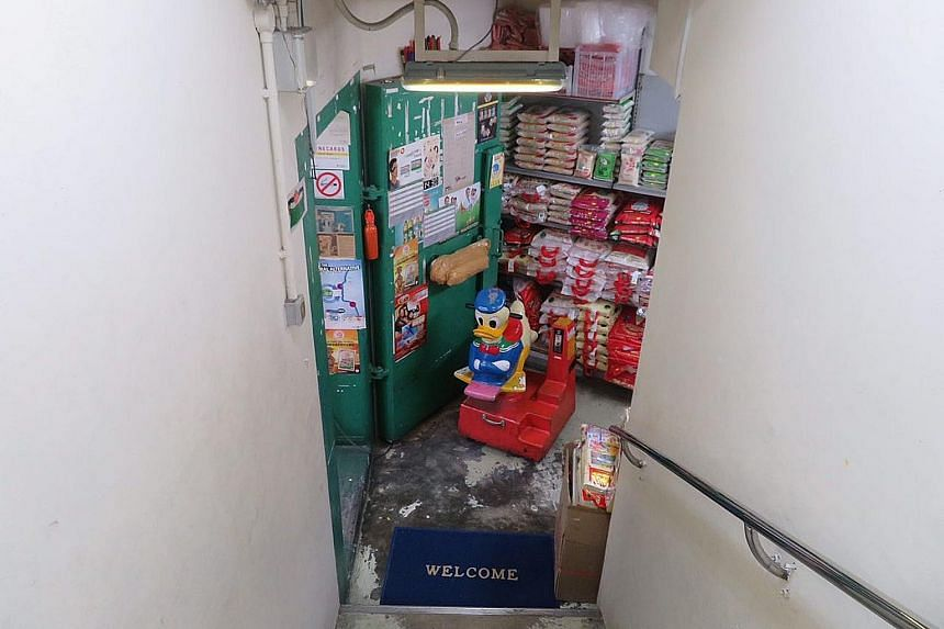 Mr Ng Han Chuan, supervisor of Hao Mart convenience store located at the void deck of Block 310, Yishun Ring Road, said they close the bomb shelter's heavy metal door every night for added security.