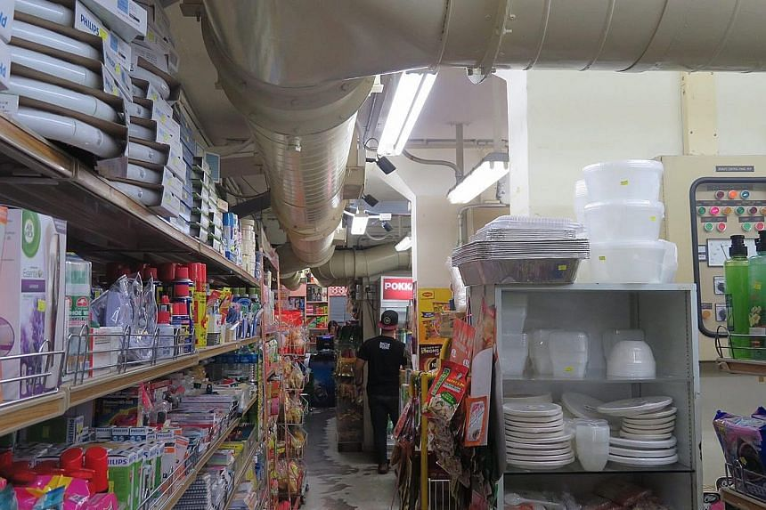 Businesses located in bomb shelters cannot alter the structure but can add lights and such, which is what Fair Price Underground Superstore has done. Fair Price Underground Superstore in the basement of Block 539, Hougang Street 52. The store's super