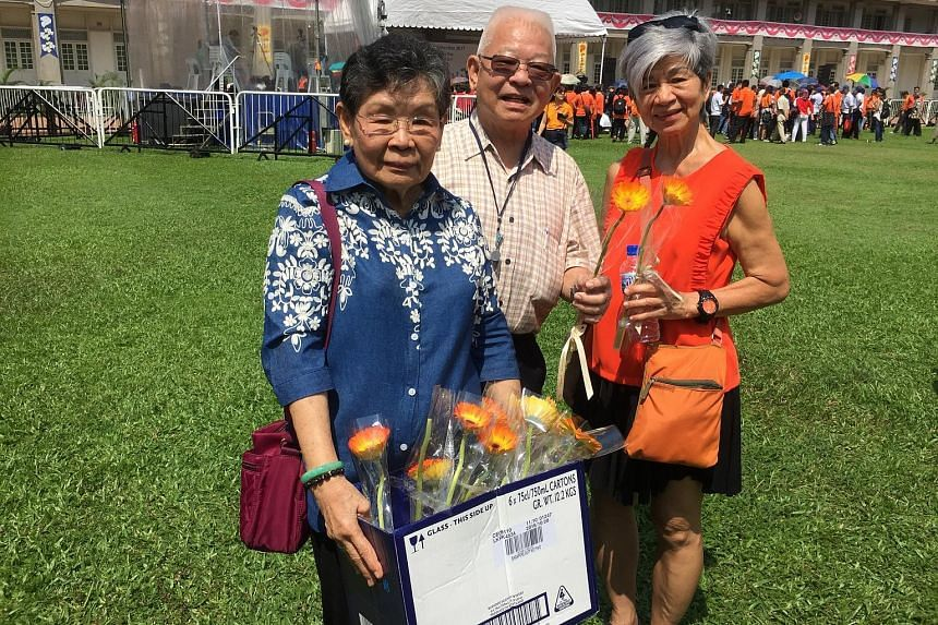 Mr Koh Heong Hwee, his wife Goh Lian Choo (left) and fellow Buona Vista CC member Theresa Toh at the nomination centre yesterday.