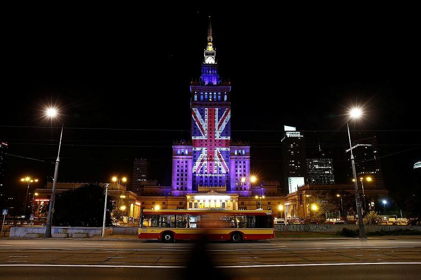 The Palace of Culture and Science in the Polish capital Warsaw lit up in the colours of the Union Jack last year to support Britain's staying in the EU. Yesterday, European Commission chief Jean-Claude Juncker signalled that Britain would regret its