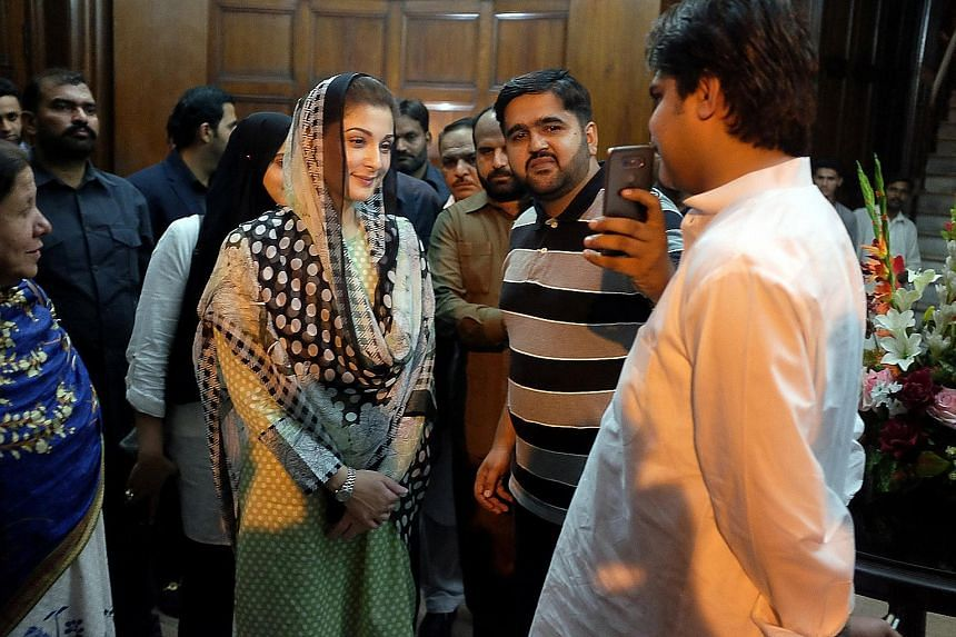 Ms Maryam Nawaz, the daughter of ousted Pakistani prime minister Nawaz Sharif, with a supporter at a rally in Lahore last Saturday. The ruling PML-N party has made Ms Maryam - a telegenic but inexperienced politician - the face of its campaign in a b