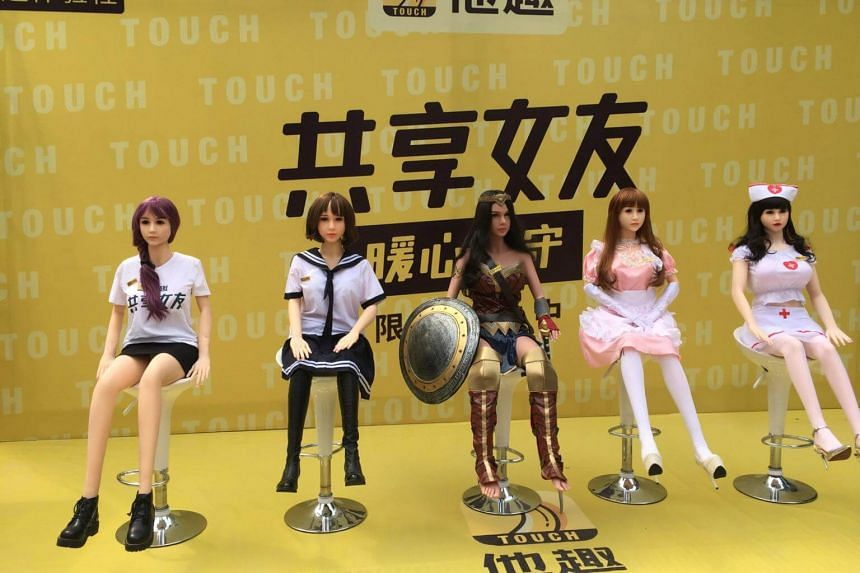 """Shared girlfriend"" sex dolls on display on a promotional event in Beijing on Sept 14, 2017."
