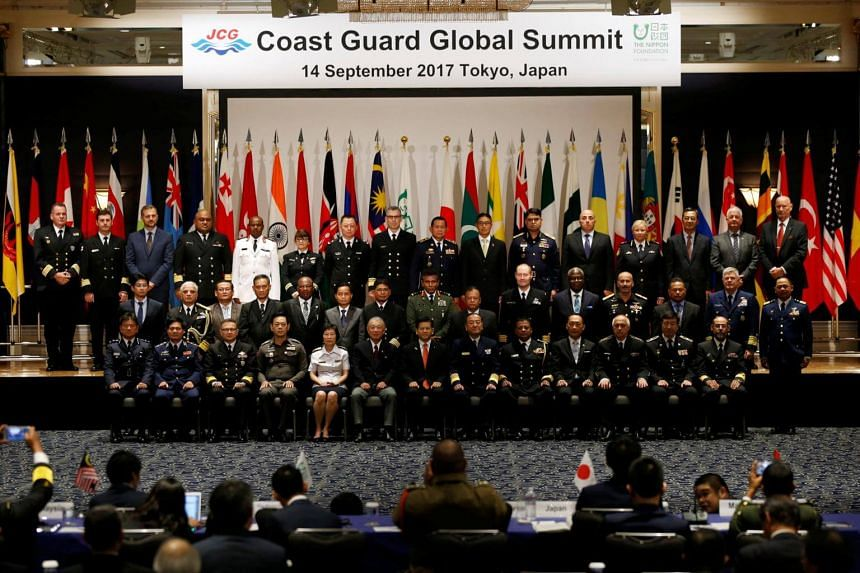 The heads of coast guard from over 30 nations posing for a group photo at the Coast Guard Global Summit in Tokyo on Sept 14, 2017.