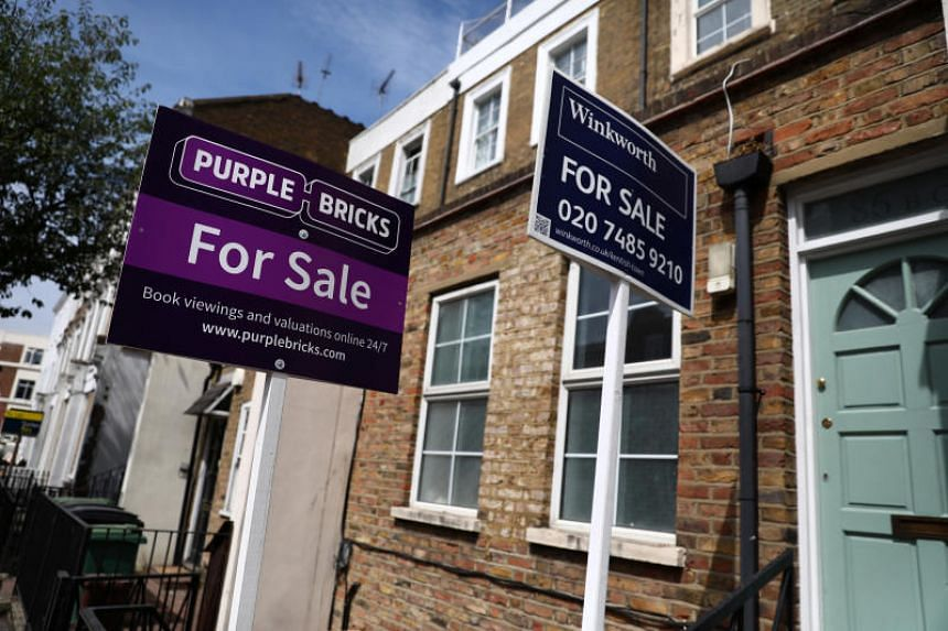 Estate agent boards are displayed outside a property in London, July 7, 2017.