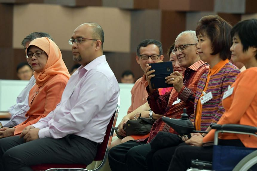 Madam Halimah Yacob and her campaign team going through the nomination proceeding inside the centre.