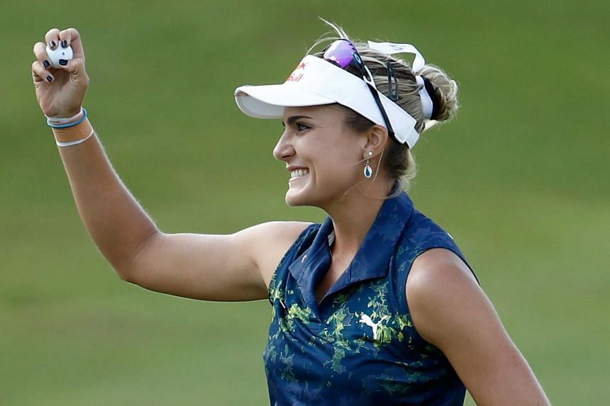 Lexi Thompson celebrates after winning the Indy Women In Tech Championship on Sept 9, 2017.