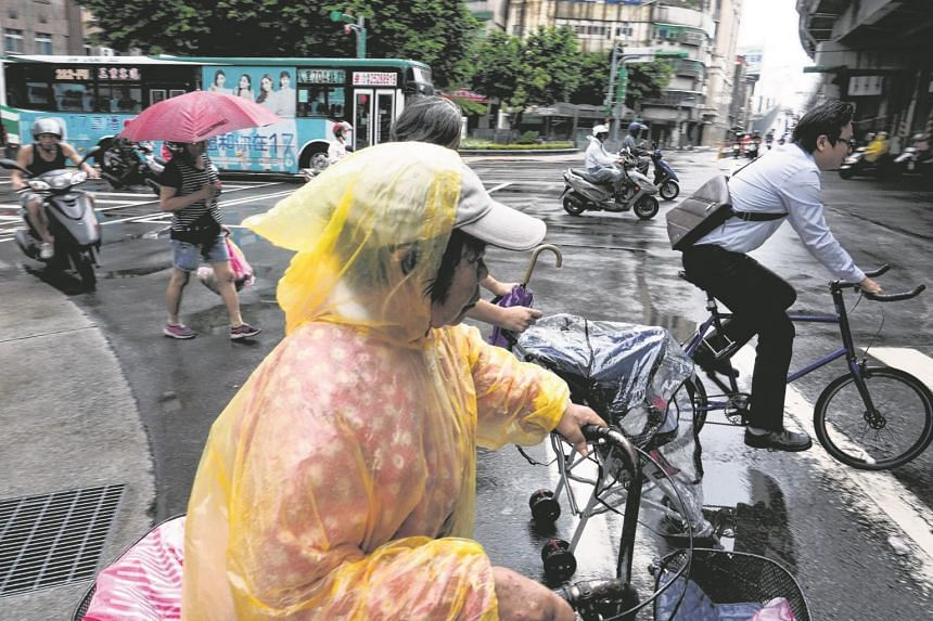Typhoon Talim brought sporadic wind and showers to Taipei on Wednesday (Sept 13). It has now shifted north and will not make landfall in Taiwan, although the capital and other cities can expect heavy rain from the storm.