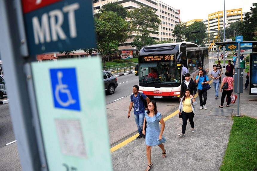 Commuters at a bus stop in Yishun. A new bus service will start serving residents in Yishun on Oct 15.
