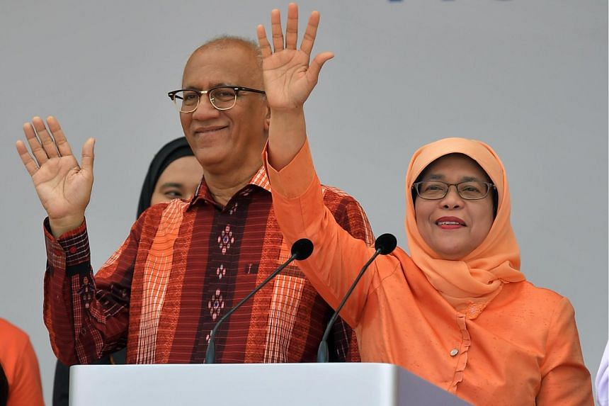 Madam Halimah Yacob and her husband Mr Mohamed Abdullah Alhabshee waving to her supporters after delivering her speech at the People's Association HQ in King George's Avenue.