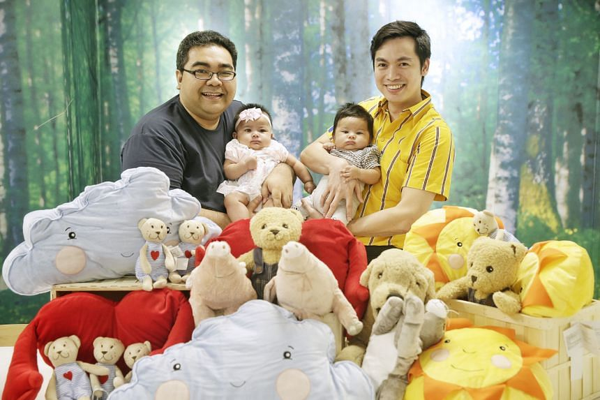 Among the new fathers at Ikea who have benefited from its paternity leave are Mr Masree Mascomb (left), with his daughter Nur Maisarah, and Mr Dingson Balahadia, with his son Elijah Diego.