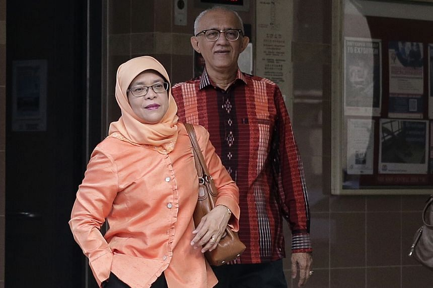 Madam Halimah Yacob and husband Mohamed Abdullah Alhabshee leaving their flat to head to the nomination centre yesterday.