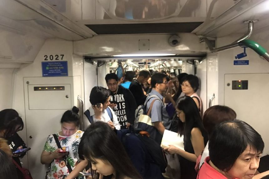Commuters on a train along the NSL on Friday (Sept 15) night.