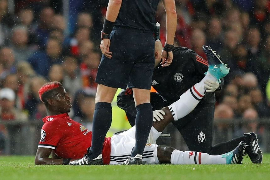 Pogba receives medical attention after sustaining an injury, Sept 12, 2017.
